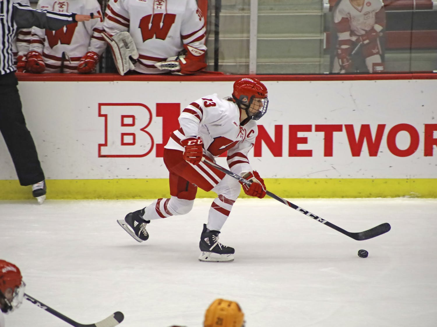 Defenseman Grace Bowlby handles the puck as the Badgers take down top-ranked Minnesota.