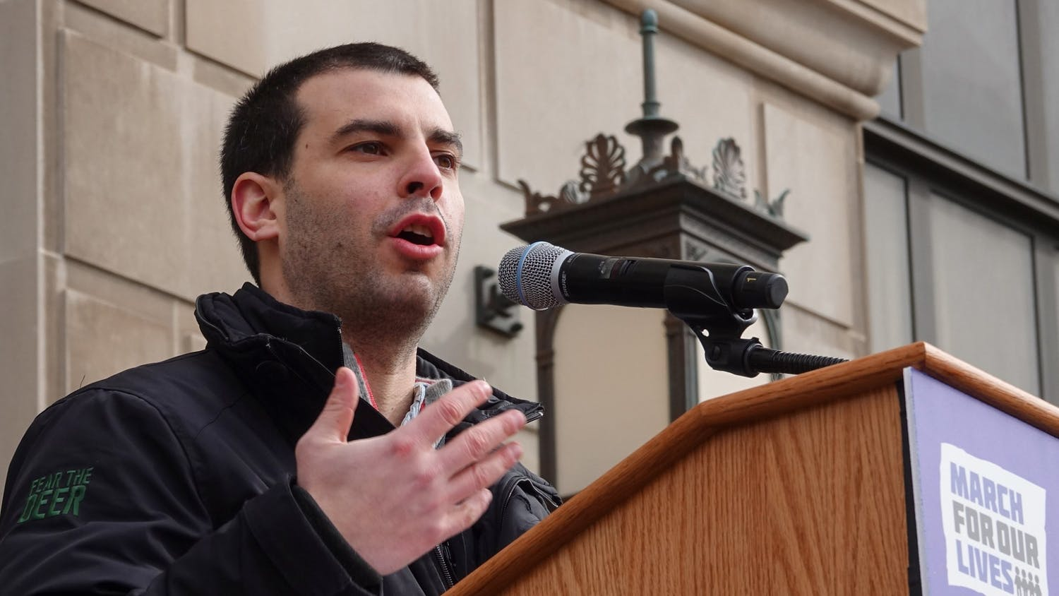 Alex Larry speaks at a rally