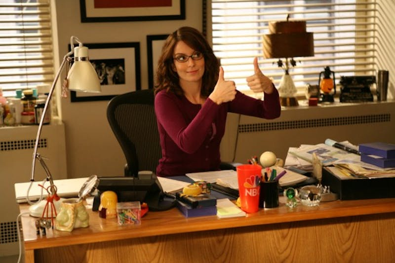 Tina Fey, writer and star of '30 Rock' responds to criticism in wake of racial tensions by removing blackface episodes.