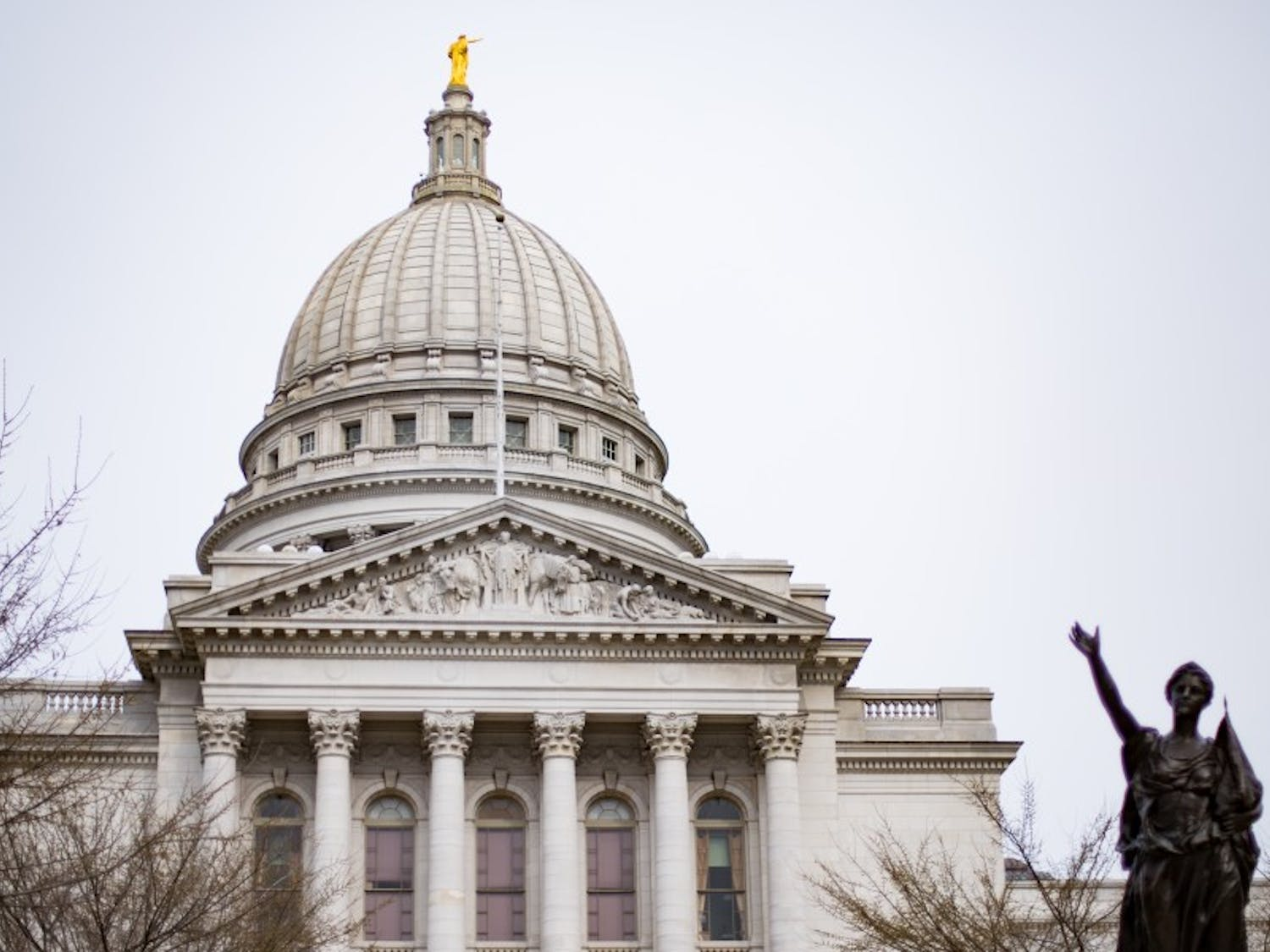 Gov. Scott Walker used his veto power to reject certain aspects of the state's two-year budget, some of which will affect the UW System.