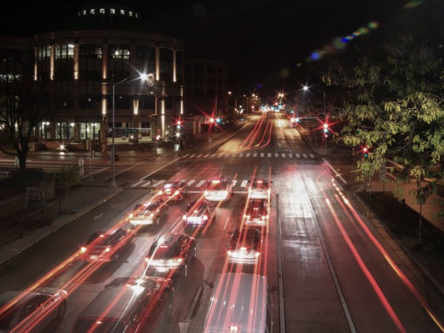 Cars headed west down University Avenue at the intersection of Park Street and University Avenue under long exposure, taken from the pedestrian footbridge.