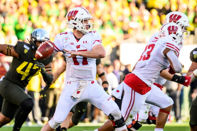 Quarterback Jack Coan looks downfield to pass the ball during the Rose Bowl game in Pasadena, California as the University of Wisconsin-Madison Badgers played the University of Oregon on Jan. 1, 2020. The Badgers lost the football game 28-27. (Photo by Bryce Richter / UW-Madison)