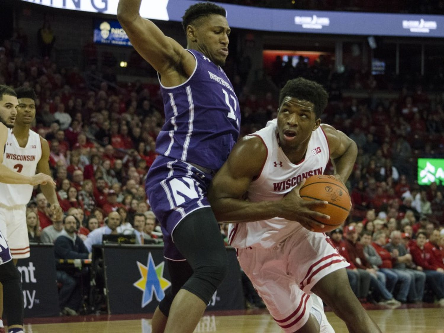 Junior forward Khalil Iverson scored 16 points as Wisconsin knocked off Northwestern, 70-64.