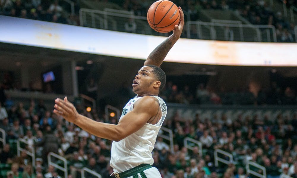 Sophomore forward Miles Bridges (22) dunks the basketball during the game against Ferris State on Oct. 26, 2017, at the Breslin Center. The Spartans defeated the Bulldogs, 80-72.