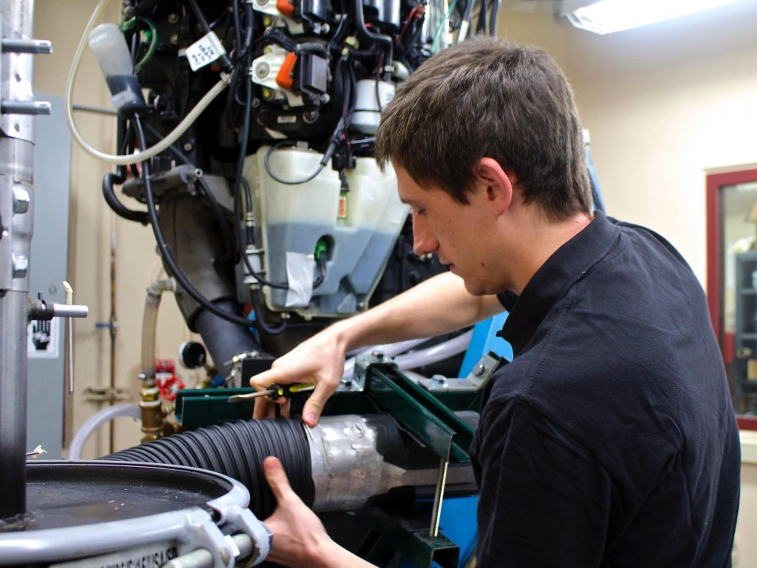 Kieran McCabe, a graduate student in UW-Madison's College of Engineering, will conclude a nearly two-year project testing an Evinrude outboard motor for the company BRP before he graduates. McCabe is one of many students throughout the UW System sharing their talents with businesses in Wisconsin and beyond.