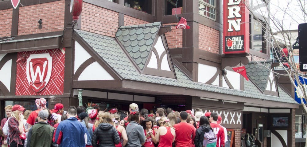 <p>Madison area students gather outside&nbsp;a popular campus bar. Gatherings at or near bars pose a great risk to all.</p>