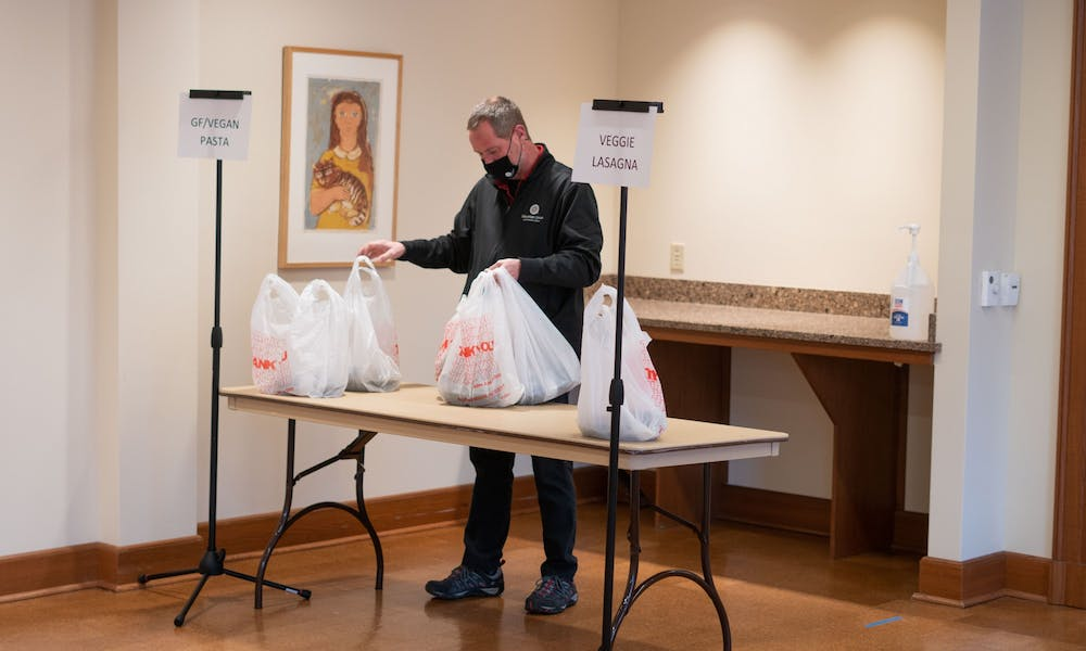 A man is bagging food for food insecure students and those who have signed up for the service at Union South.