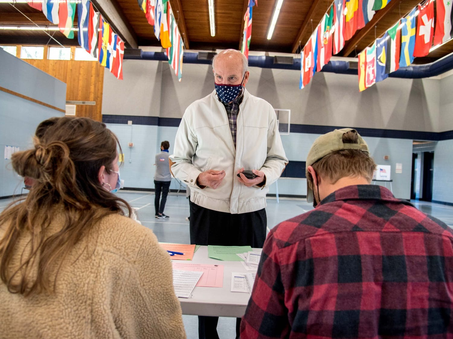 George Warren checks in to his polling place at the Eagle Heights Community Center in Madison, Wis., on the day of the November 3, 2020 election.