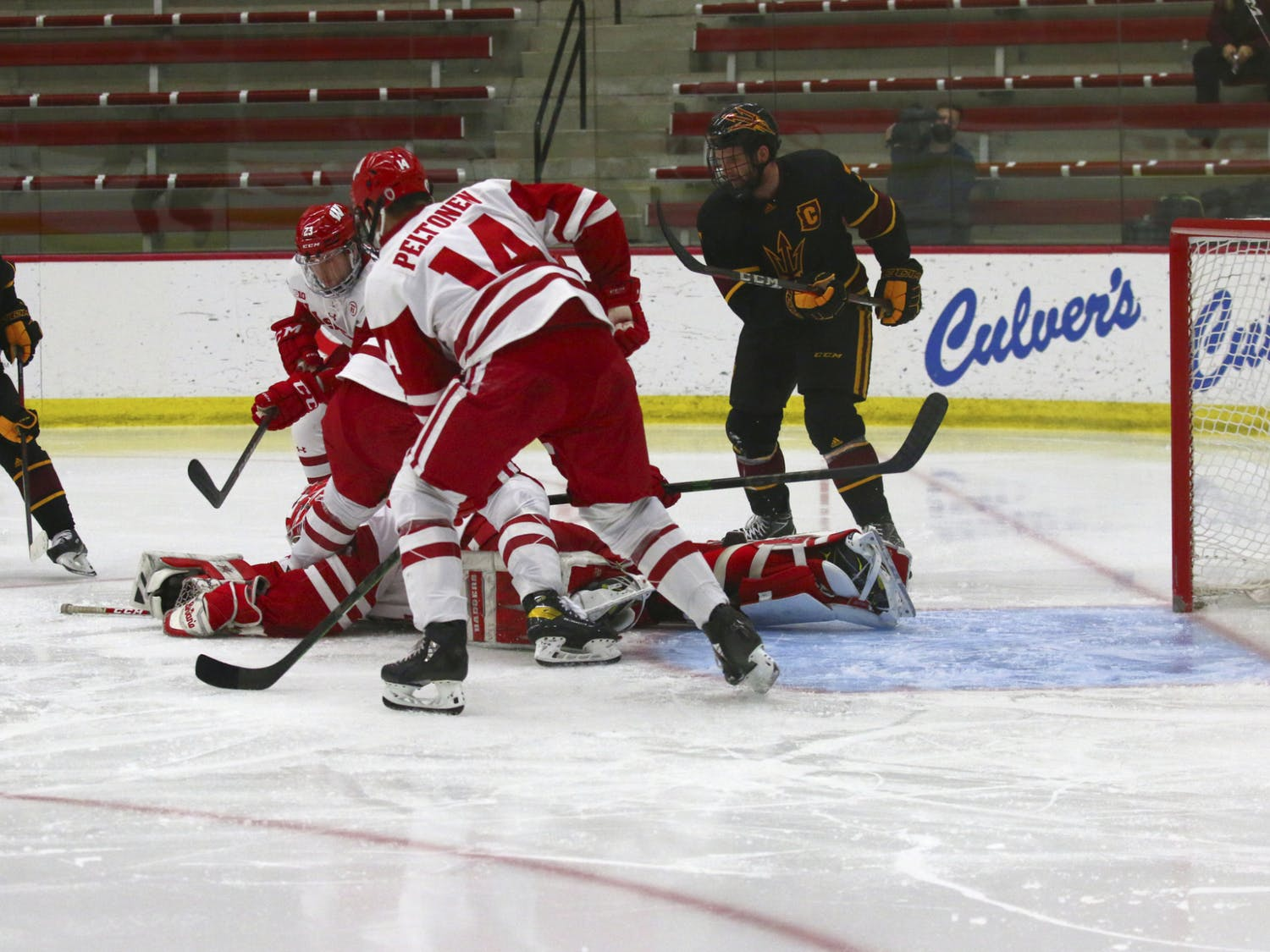 Freshman goaltender Cameron Rowe dives for a save as the Badgers sweep Arizona State.