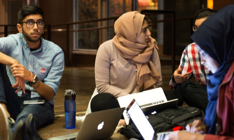 Several students, including Chair of the Shared Governance Committee Omer Arain, watch as election results pour in with Donald Trump leading.