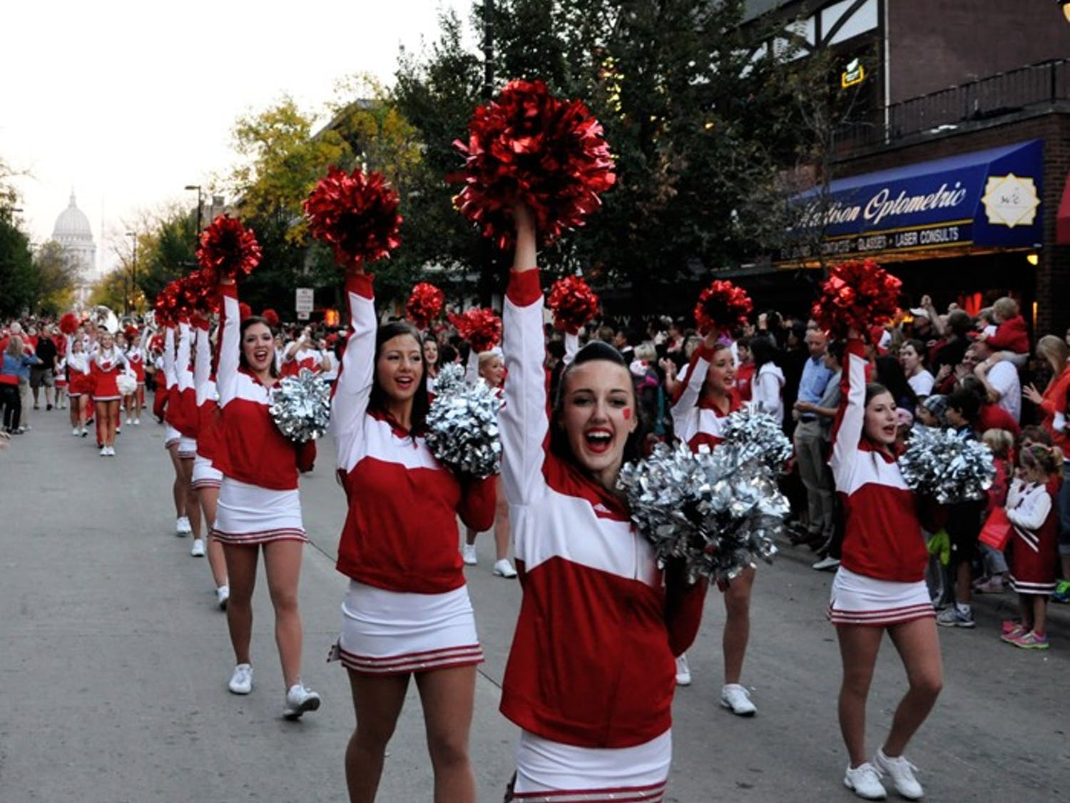 Current UW-Madison students and alumni gather together on State Street Friday to celebrate the annual homecoming parade.
