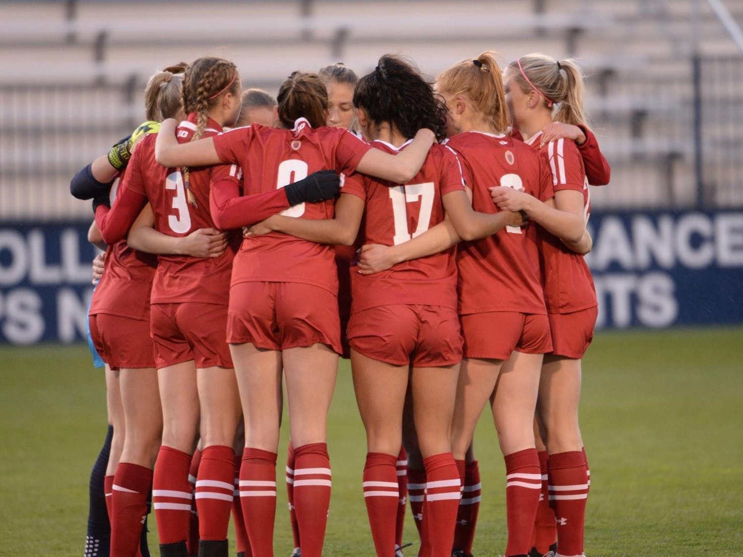 Photo of the Badger soccer team in a huddle.