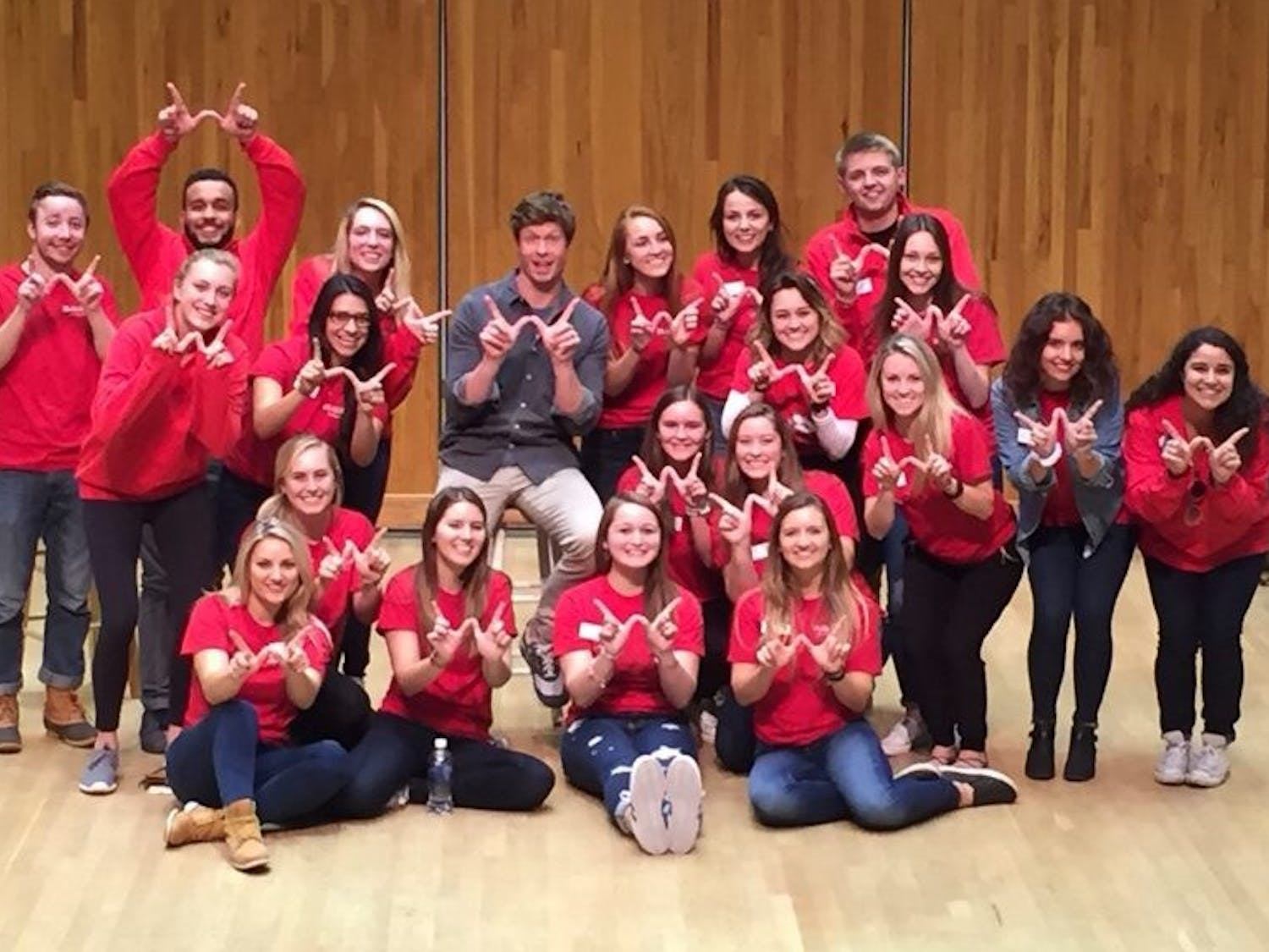 """Anders Holm, a UW-Madison alumnus who stars in Comedy Central's series, """"Workaholics,"""" poses with members of UW-Madison Homecoming Committee after his """"RED Talk"""" which kicked-off homecoming week."""