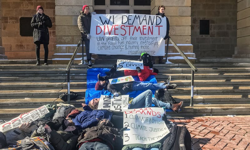 The protests in front of Bascom Hall accused UW-Madison of making significant investments in the fossil fuels industry — which have played a negative role in climate change.