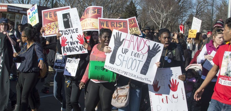 Protesters marched through Madison on Wednesday to voice concerns over structural injustices in the community.