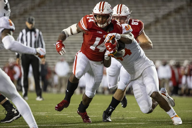 Wisconsin Badgers running back Nakia Watson (14) carries the ball during an NCAA college football game against the Illinois Fighting Illini Friday, Oct. 23, 2020, in Madison, Wis. The Badgers won 45-7. (Photo by David Stluka/Wisconsin Athletic Communications)