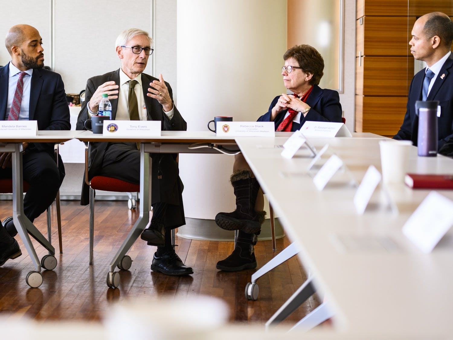 Wisconsin Gov. Tony Evers, at left of center, flanked by Lt. Gov. Mandela Barnes and UW-Madison Chancellor Rebecca Blank, meets with faculty, staff and student researchers in the Wisconsin Institute for Discovery during Evers's tour of the Discovery Building at the University of Wisconsin-Madison on March 5, 2019. (Photo by Jeff Miller / UW-Madison)