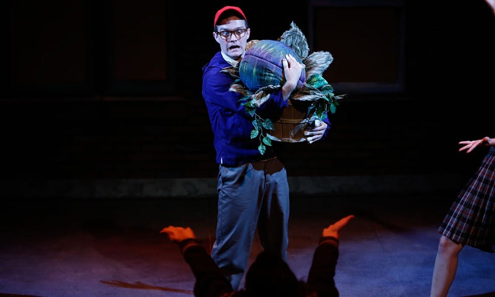 """With comical performances and a bizarre plant that talks and sings, """"Little Shop of Horrors"""" has it all."""