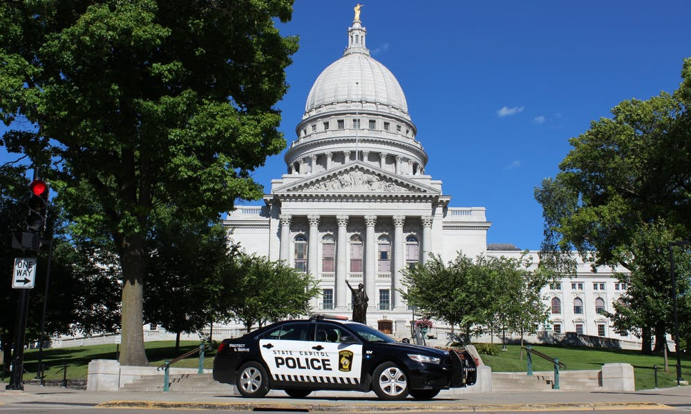 Photo of a State Capitol Police car in front of the Wisconsin State Capitol.