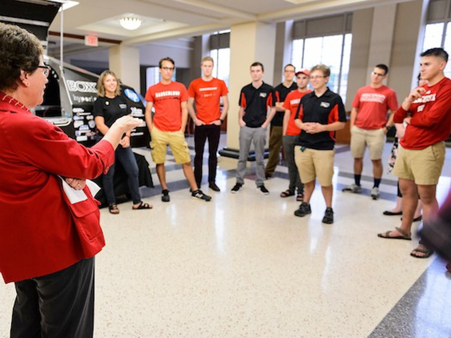 Standing near a 2016-era Badgerloop Pod, Chancellor Rebecca Blank visits with members of the College of Engineering's Badgerloop team at the Mechanical Engineering Building at the University of Wisconsin-Madison on Aug. 16, 2017. The group is preparing to depart for and compete with their 2017-era Badgerloop Pod II -- already in shipping transit -- in the international SpaceX Hyperloop Competition II Aug. 25-27, 2017, in California. A hyperloop involves a pod moving in a low-pressure tube at hundreds of miles per hour. The sole criteria for the 2017 SpaceX competition is speed. (Photo by Jeff Miller / UW-Madison)
