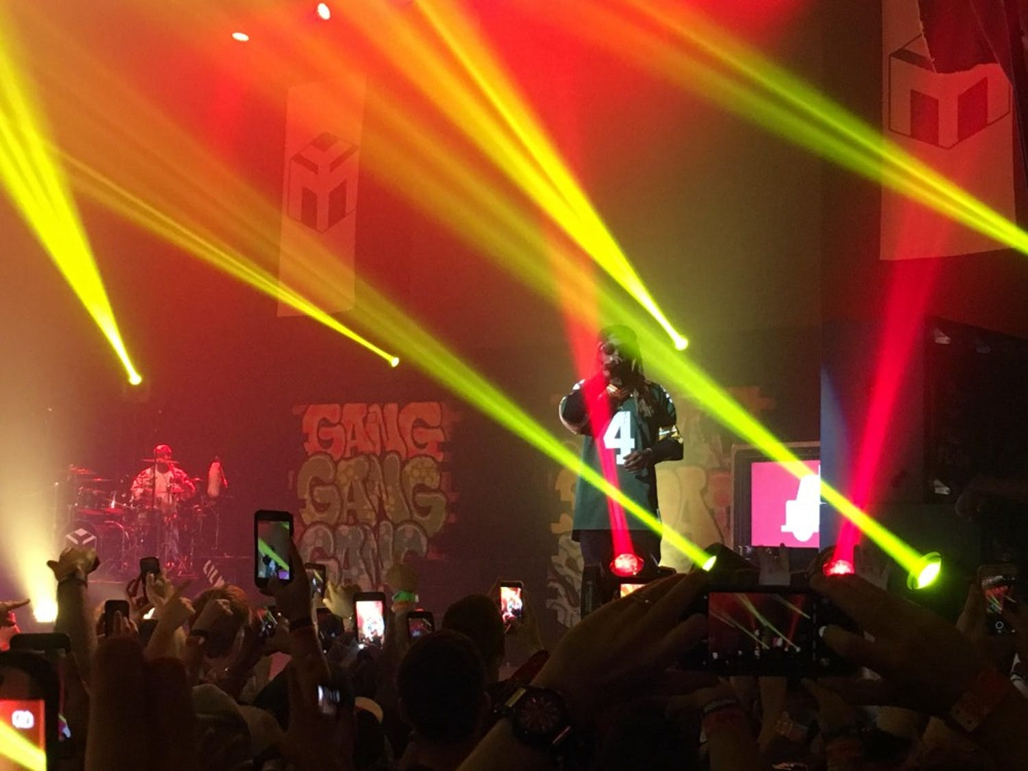 Wearing a customized Favre jersey, Lil Wayne performed classic tracks during the sold-out show.