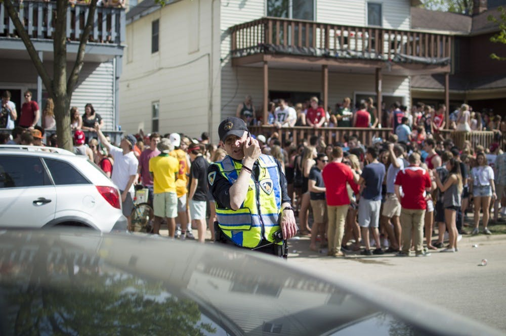 Photo of a police officer monitoring the Mifflin Block Party.