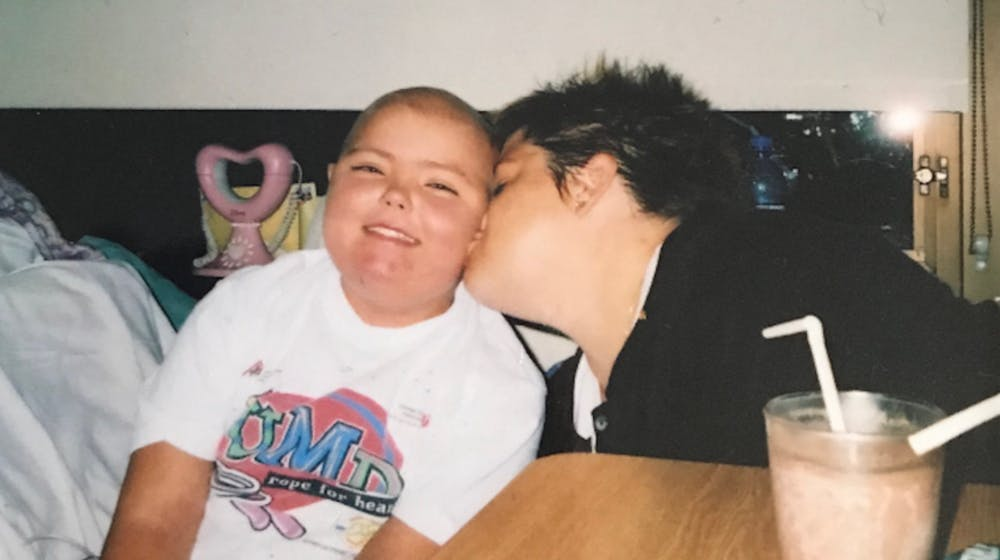 <p>&nbsp;Kristina Schultz shares a moment with her mother Lori.</p>