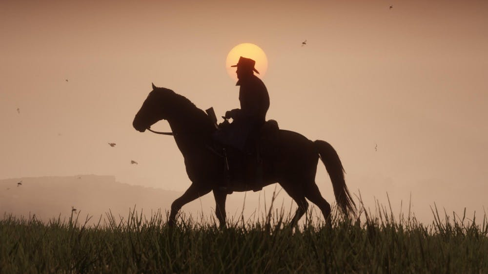 """Compared to Rockstar's earliergames, """"Red Dead Redemption 2"""" feels like a visual novel, more a simulation of what life as a highwayman in late-19th century America may have been like than an arcade machine for the player's amusement."""