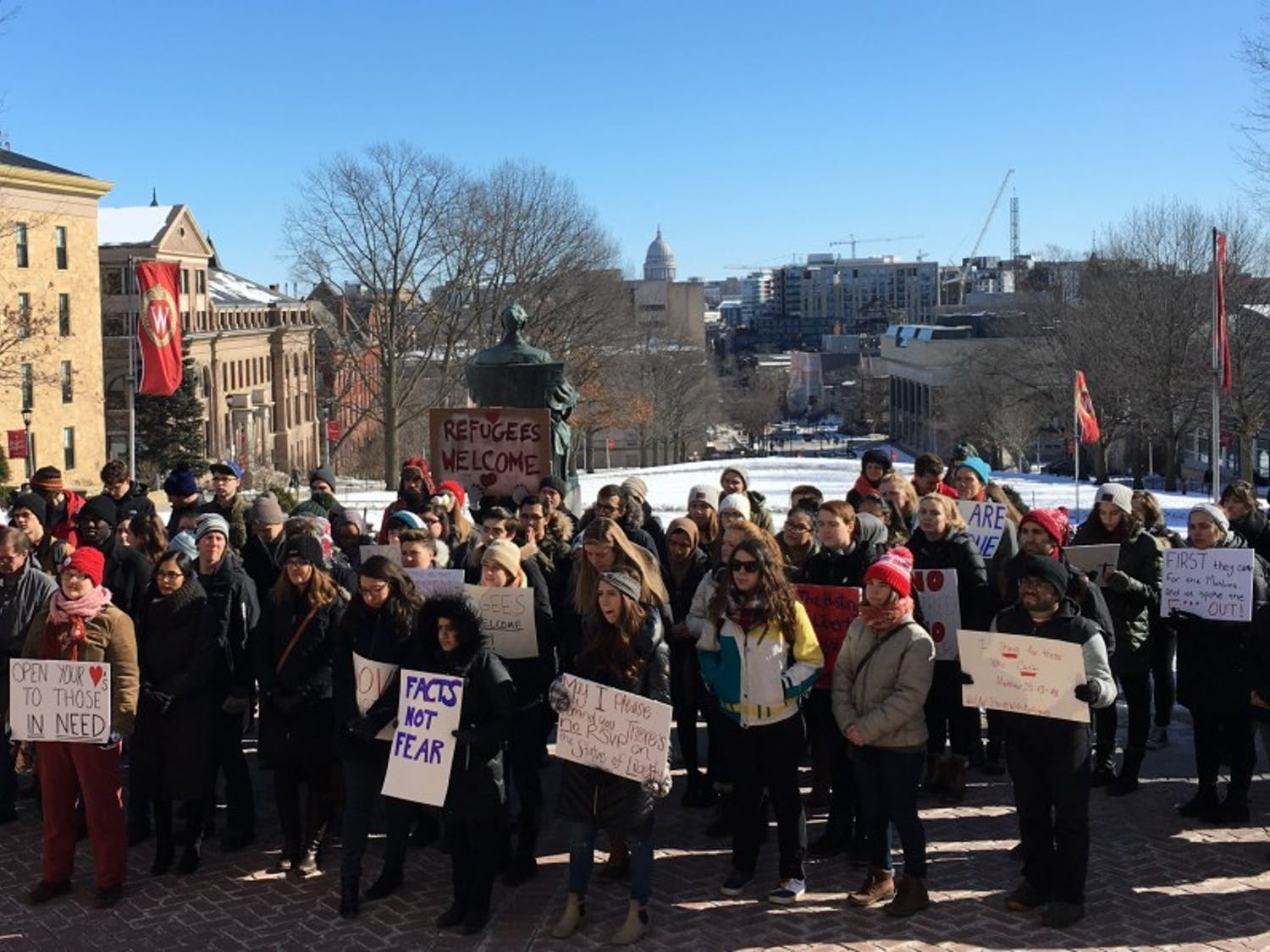 UW-Madison students braved the cold Friday andrallied on Bascom Hill to show support for refugees.