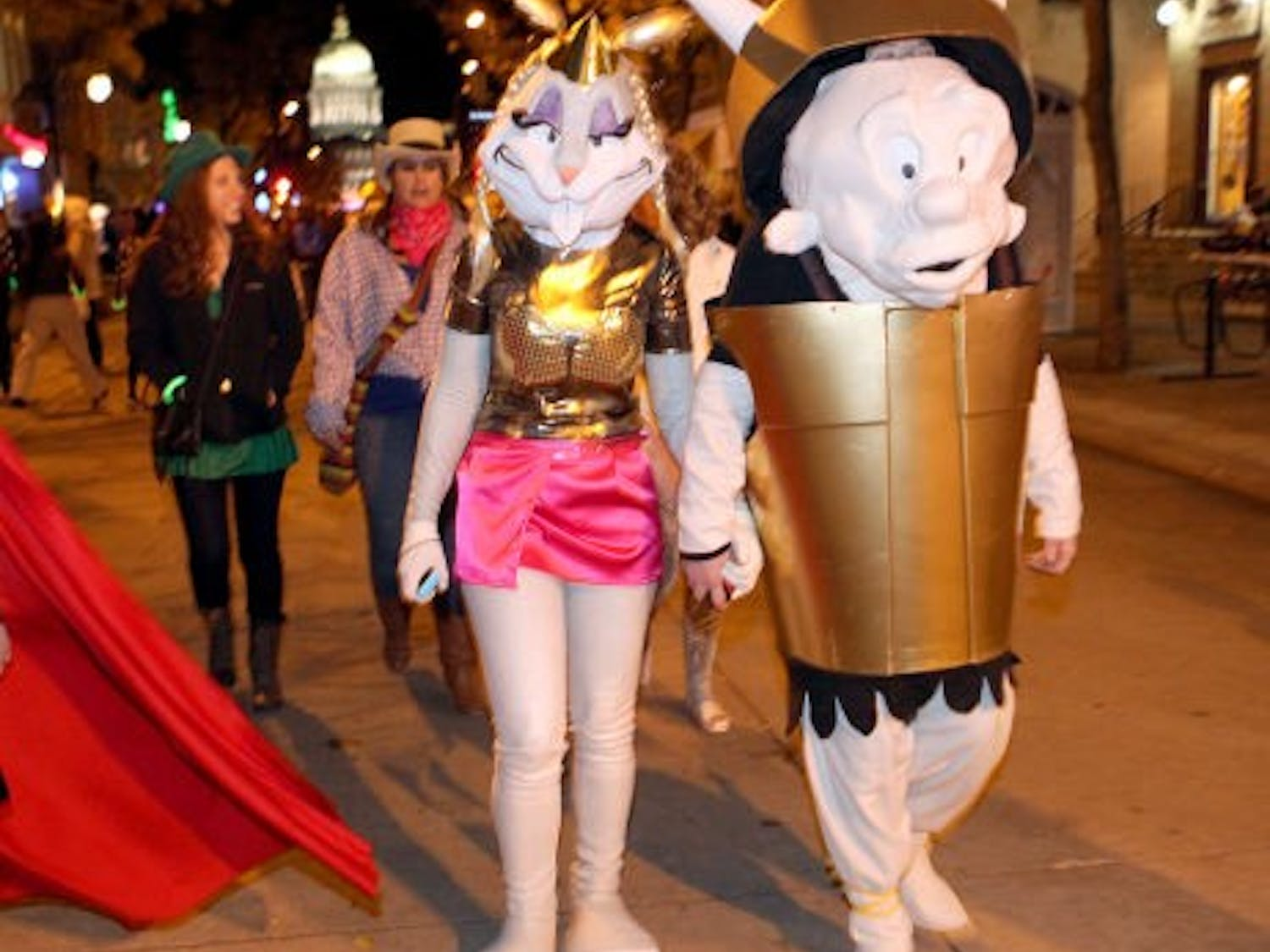 State Street's annual Halloween party drew an estimated 35,000-plus revelers, according to Madison police. Here's a look at some of them from the lenses of photographers Amber Arnold of the Wisconsin State Journal and Mike DeVries of The Capital Times.