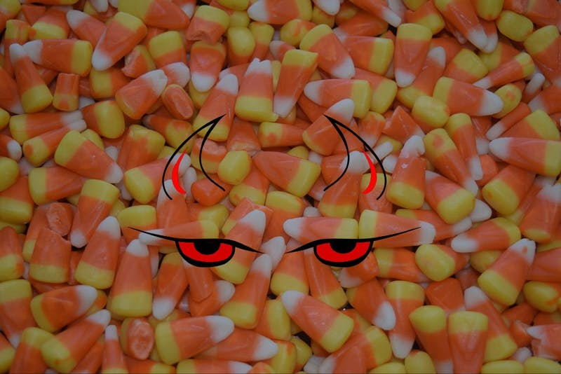 Devilish candy corn staring you down intensely, daring you to have a taste while it collects dust in your mother's decorative Halloween dish.