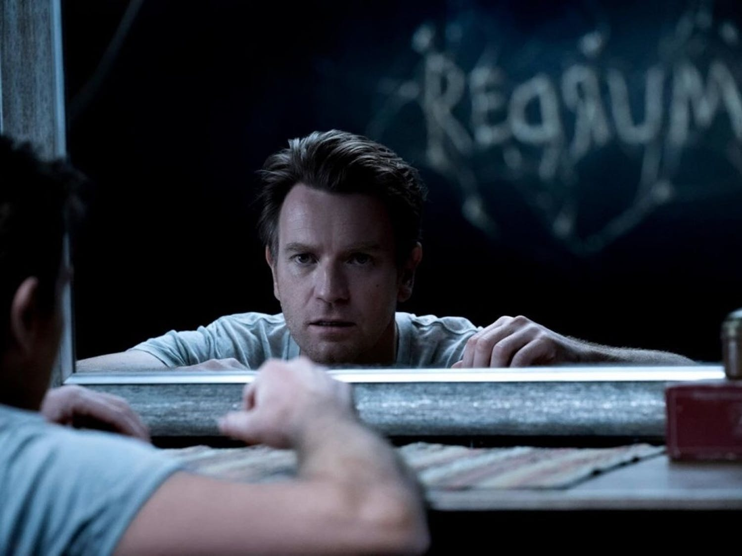"""Ewan McGregor stars as Dan Torrance in """"Doctor Sleep"""". The ghostly 'REDRUM' message on the wall harkens back to the film's predecessor: """"The Shining""""."""