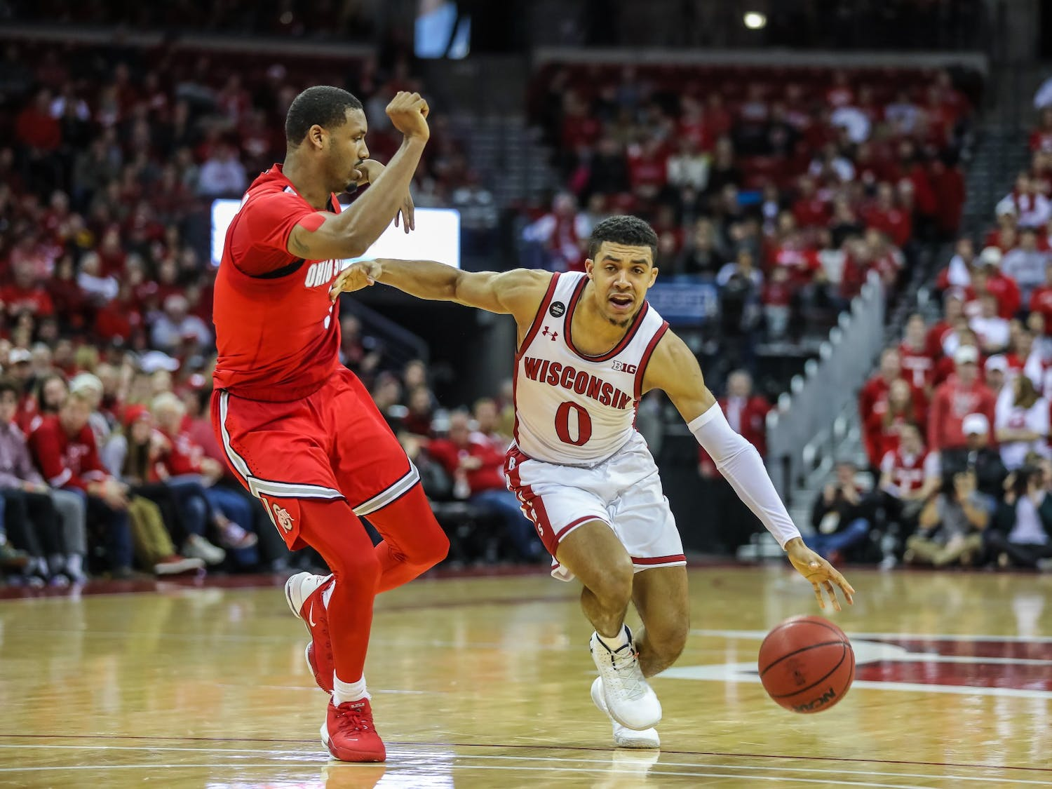 D'Mitrik Trice drives on a Buckeye defender as the Badgers take down Ohio State in the Kohl Center on Feb. 9, 2020.