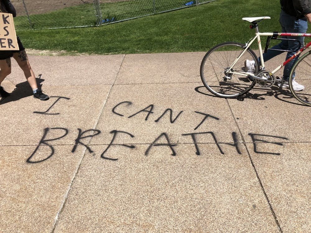 "<p>""I can't breathe"" spray-painted on the ground near the Capitol.</p> <p>12:29 p.m.</p>"
