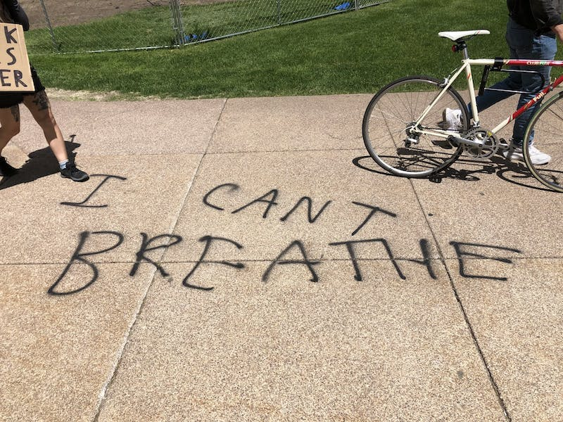 """""""I can't breathe"""" spray-painted on the ground near the capital. 12:29 p.m."""