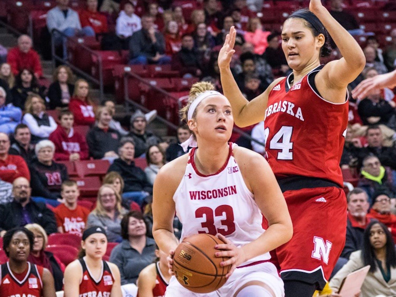 Courtney Fredrickson tied a career-high with 18 points and set a career-high with 14 rebounds, but UW still fell to Minnesota.