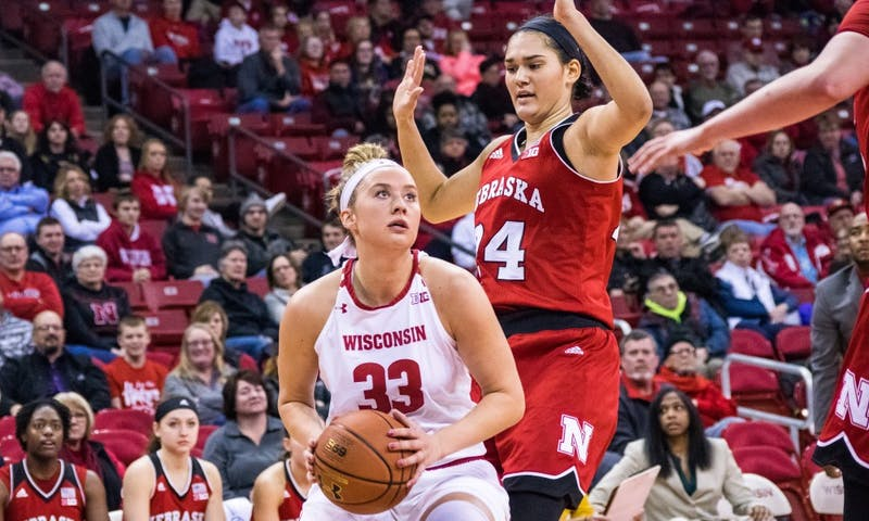 Courtney Fredrickson tied a career-high with 18 points and set a career-high with 14 rebounds, but UW still fell to Minnesota.