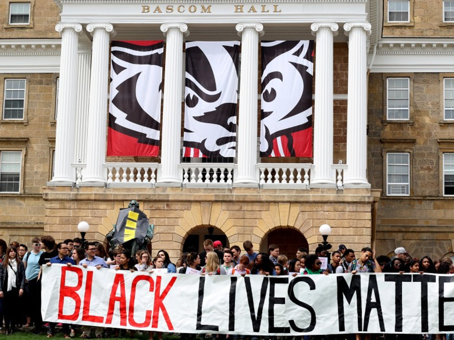 UW-Madison students, faculty and community members joined together Thursday in protest of recent incidents of discrimination on campus, including last week's arrest of a student after he was taken from a university classroom.