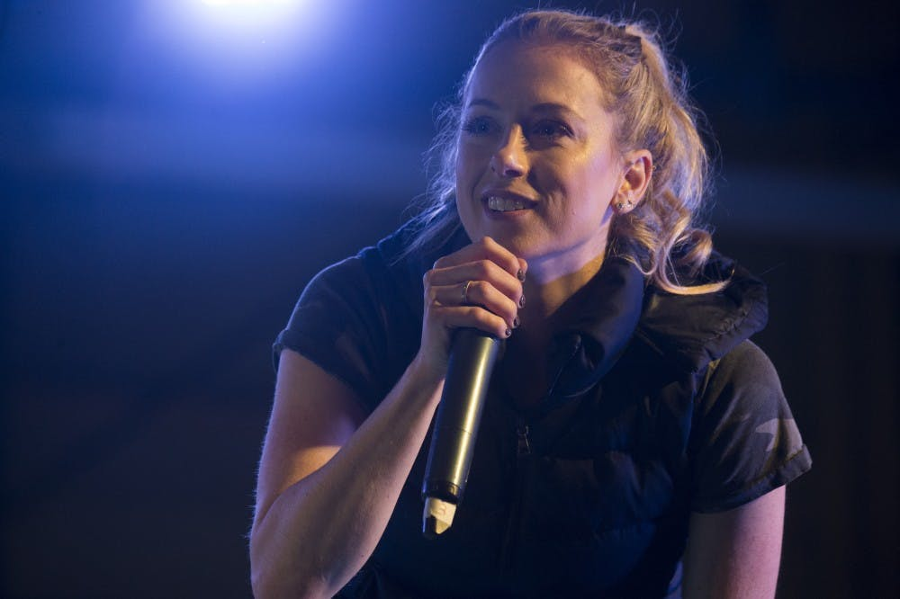 """Comedian Iliza Shlesinger performs during Chairman's USO Holiday Tour at Morón Air Base Dec. 21, 2017. Marine Corps Gen. Joe Dunford, chairman of the Joint Chiefs of Staff, and Army Command Sgt. Maj. John W. Troxell, senior enlisted advisor to the chairman, along with USO entertainers, visited service members who are deployed during the holidays at various locations across Europe and the Middle East. This year's entertainers were Chef Robert Irvine, wrestler Gail Kim, comedian Iliza Shlesinger, actor Adam Devine, country musician Jerrod Niemann, and WWE Superstars """"The Miz"""" and Alicia Fox. (DoD photo by Navy Petty Officer 1st Class Dominique A. Pineiro/Released)"""