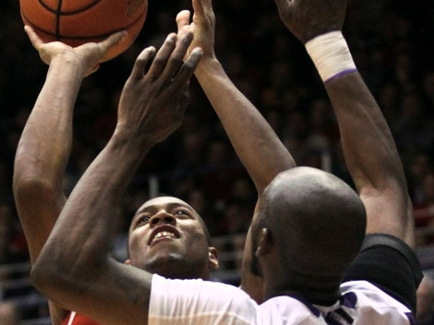 Hughes' clutch scoring pulls Leuer-less Badgers past Wildcats