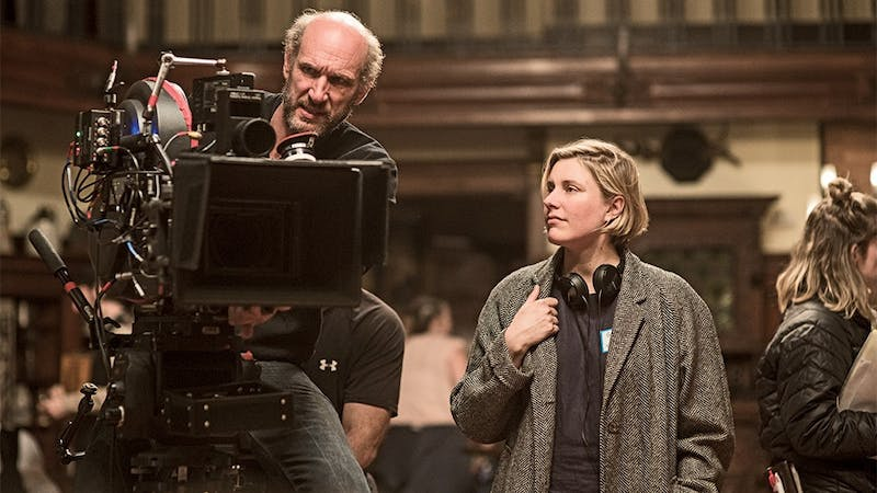 "BTS: Director/Writer Greta Gerwig and DP Yorick LeSaux on the set of Columbia Pictures' ""LITTLE WOMEN."""