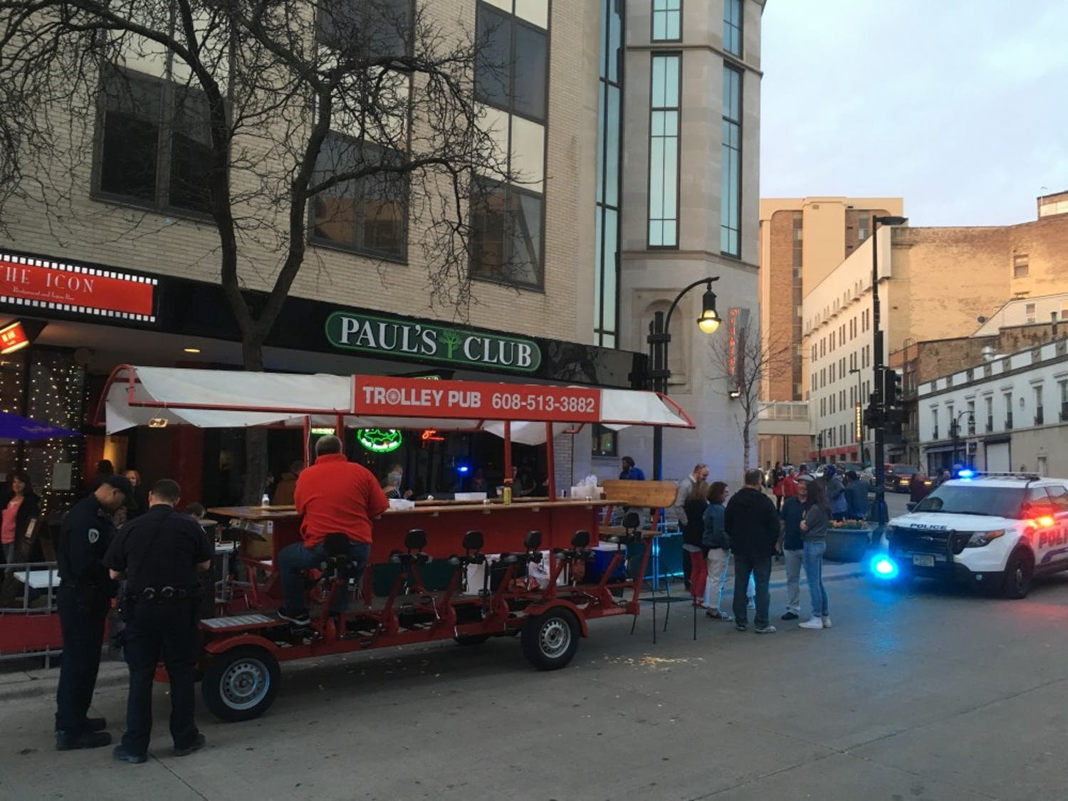 Three people sustained minor injuries after a city bus collided with a Trolley Pub Friday on State Street.