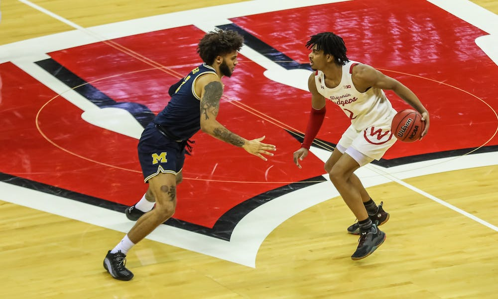 Photo of Aleem Ford dribbling across half court in a home game versus Michigan.