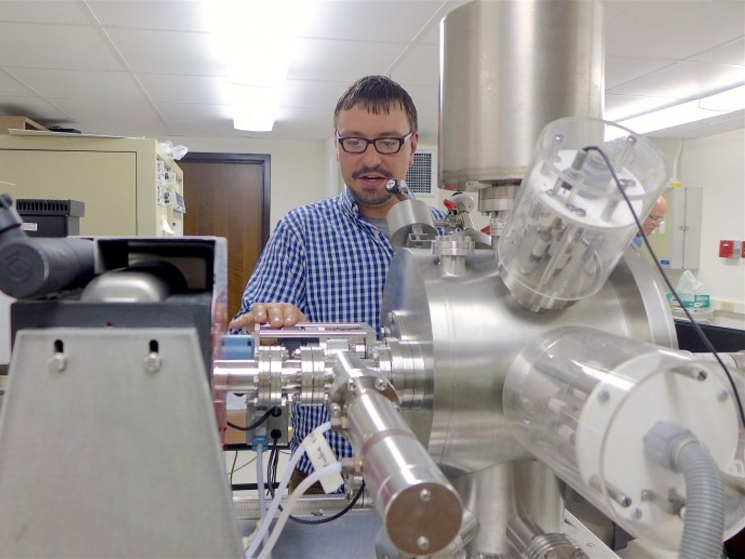 Aaron Satkoski used the UW-Madison Department of Geoscience's mass spectrometer to measure isotopes in samples collected from South Africa.