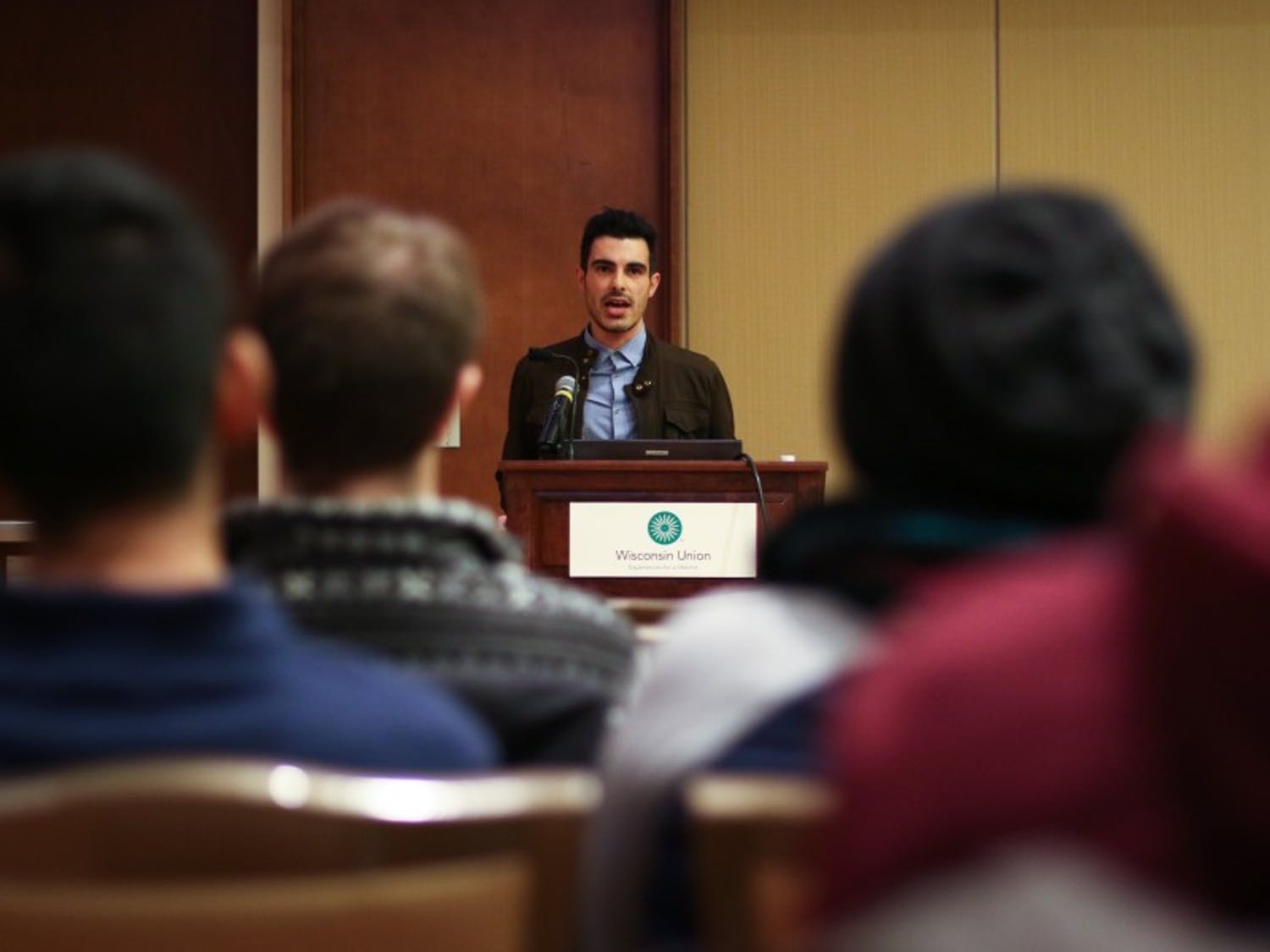 Subhi Nahas, aSyrian refugee, explains the experience of LGBTQ individuals in the Middle East  in his lecture as part of LGBTCC's Out & About Month.