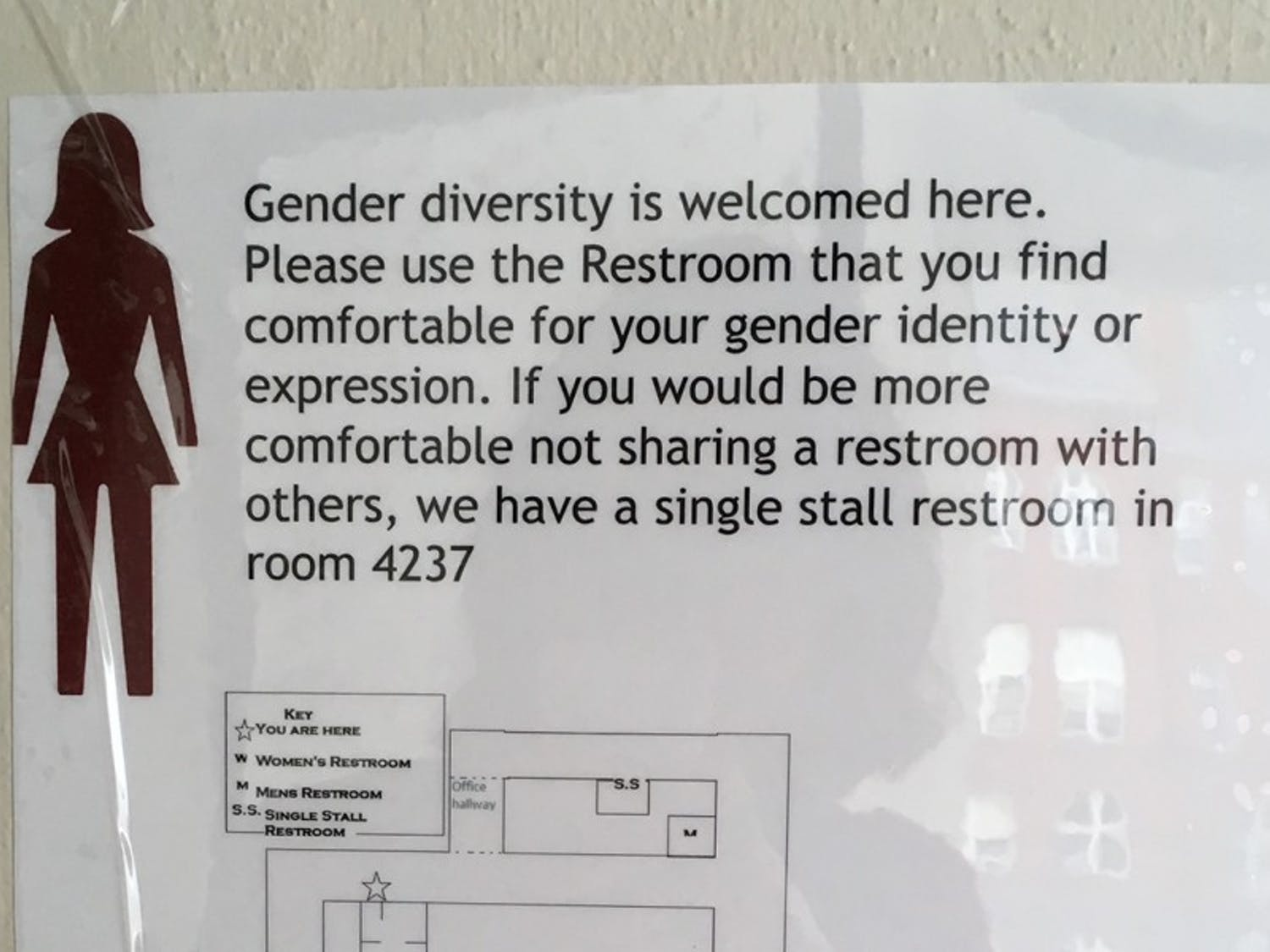 The LGBT Campus Center created a template to serve as a model for signs such as this, which is placed next to what was previously labeled a women's restroom on the fourth floor of Helen C. White Hall.