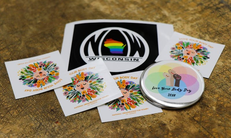 UW-Madison's National Organization for Women handed out stickers and buttons promoting body love on the UW-Madison campus.