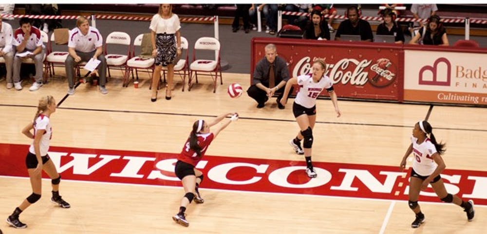 Top teams spoil Wisconsin's conference home opener