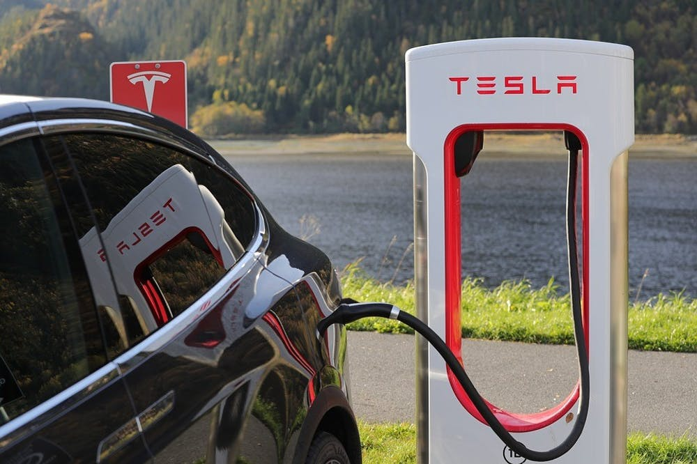 A Tesla Model 3 charges at a Tesla charging station. Photo by Creative Commons.