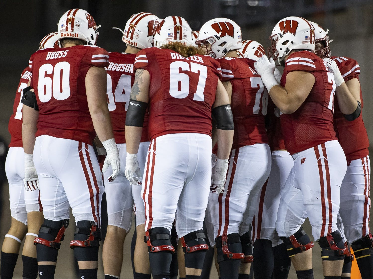Wisconsin Badgers offense huddles during an NCAA college football game against the Illinois Fighting Illini Friday, Oct. 23, 2020, in Madison, Wis. The Badgers won 45-7. (Photo by David Stluka/Wisconsin Athletic Communications)